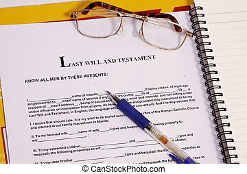 last will and testament form with notebook and pen.