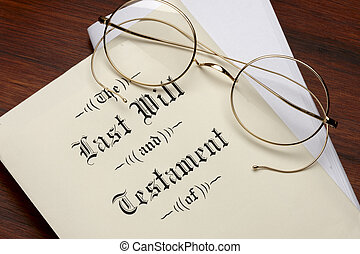 Last will and testament, wire rim glasses shot on warm wood surface