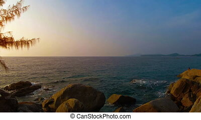 Late Afternoon Sun over a Rocky Tropical Seascape. Video 1080p 1080p