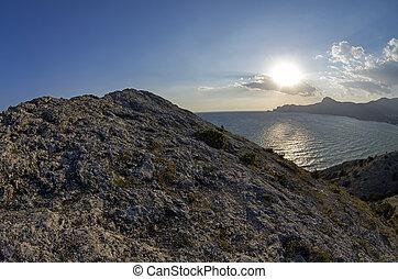 Late afternoon sun over the horizon. Crimea, September.