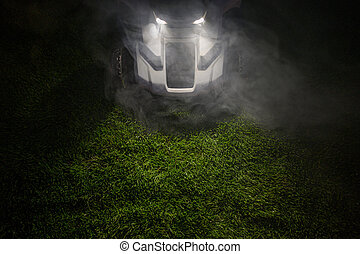 Late Evening Hours Grass Field Mowing Using Modern Wireless Electric Mower