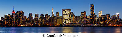 Late evening New York City skyline panorama