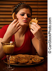 Late Night Binge - Young lady having a late night binge of...