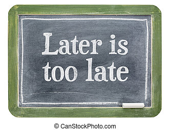 Later is too late - motivational text on blackboard
