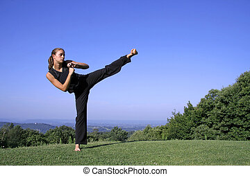 kick - lateral kick - attractive young woman practicing self...