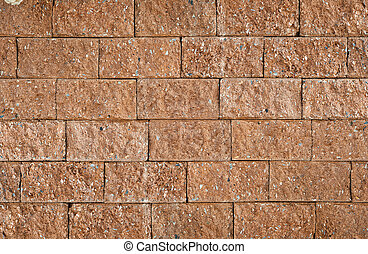 Detail and pattern of old laterite brick wall.