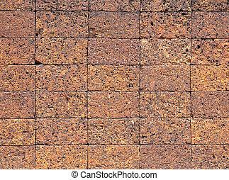 Laterite stone brick wall.