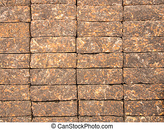 Laterite Stone Wall, Background