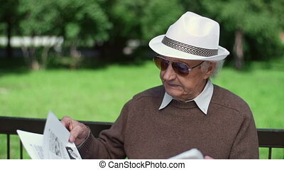 Latest News - Close up of elderly man finishing his...
