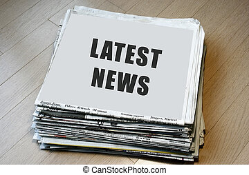 Latest News - Stack of newspaper with latest news on top