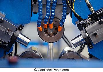 Lathe innards in machine shop