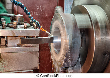 lathe machine - Facing operation of a metal blank on turning...