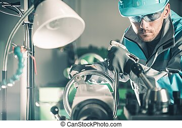 Lathe Metalwork Production Line. Caucasian Worker Preparing...