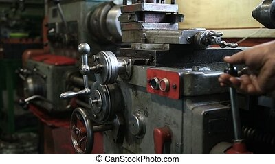Lathe turning machine getting ready to work. Man operating...