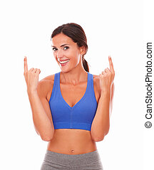 Latin adult woman exercising pointing up