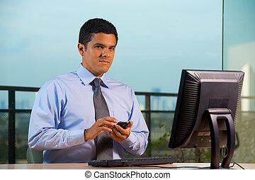 Latin American Businessman Smartphone Looking At Camera