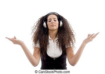 latin american female enjoying music