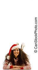 latin american model wearing christmas hat and looking at camera with white background