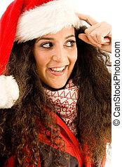 latin american model wearing christmas hat looking sideways