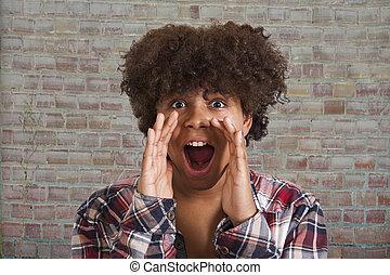 Latin American young woman screaming