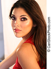 Beautiful Hispanic woman. Professional make-up applied.