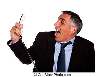Latin business man laughing with a phone