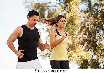 Latin couple doing some exercise