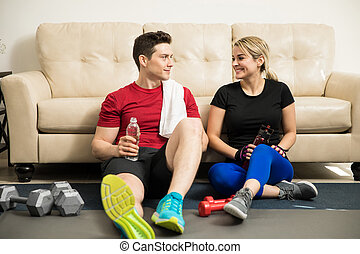Latin couple taking a break from exercising