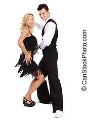 Latin dance - Beautiful blond and brunet dancing salsa on...