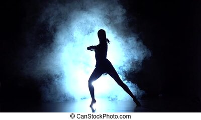 Latin dance in the studio, silhouette. Slow motion