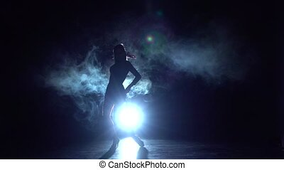Latin dance performed by a spectacular, long-legged girl....