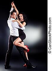 latin dance - Beautiful couple of professional artists...