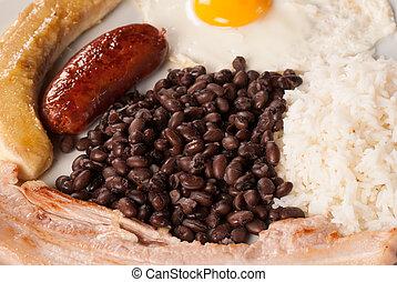 Latin food - Closeup of  a hearty Colombian bandeja paisa