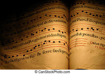 An old Christian Hymn book, normally used in choirs with musical notes and written in Latin