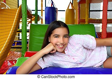 Latin indian teen girl smiling in playground schoolgirl
