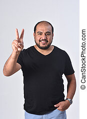 latin man with finger in the shape of number two