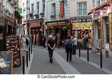 Latin Quarter of Paris, France. Narrow street of Paris among...