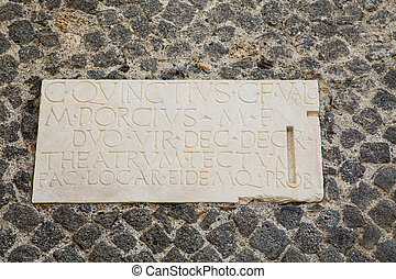Latin Script on Stone Wall in Pompeii