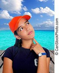 Latin teen hispanic pensive girl orange cap