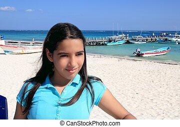 latin teen tourist girl in caribbean Mexico beach