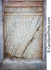 Latin text in stone