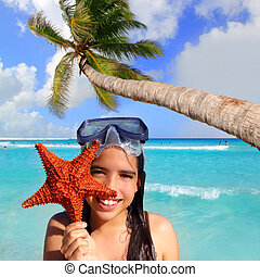 latin tourist girl holding starfish tropical beach - latin...