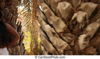 Latin Woman at Palm Tree