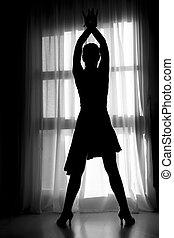 Latin woman dancing silhouette