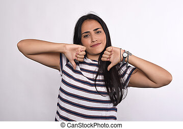 Latin woman with fingers down.