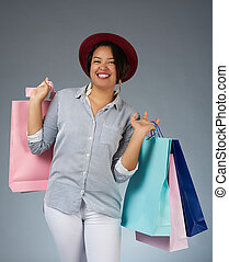 Latin woman with shopping bags