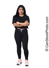 latin woman with sportswear on white background, arms crossed