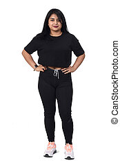 latin woman with sportswear on white background, hands on hip