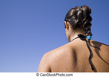 Latina - the back of a latino woman after a bath