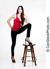 Latina Woman Standing With Foot On Wooden Stool